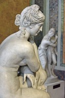 Crouching Aphrodite with Dolphin